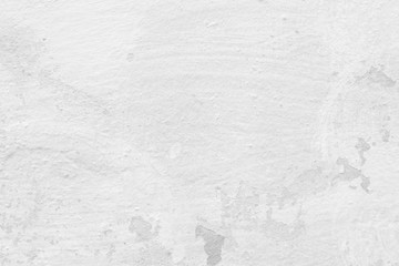 Close-up of a stone or concrete wall painted in white, paint slightly peeled off. Full frame texture background in black and white. Wall mural