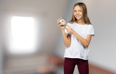 Girl holding alarm-clock