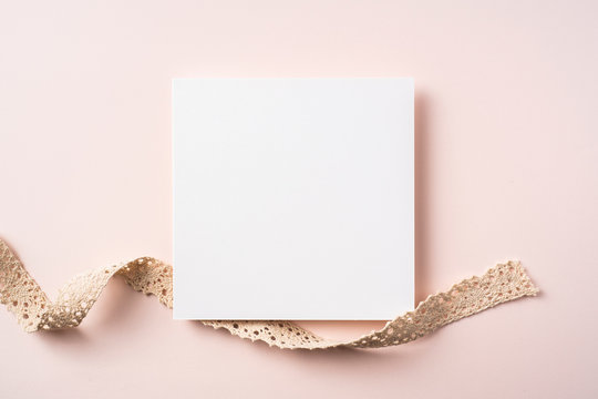 top view of carnation with card on pink background