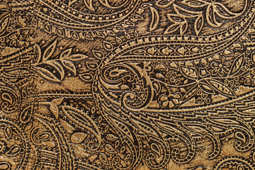 Texture of fragment genuine leather with an abstract ornament close-up. For background , backdrop, substrate, composition