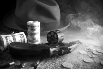 Guns and money.Gangster coat,bullet,dollars .The concept of crime.Smoky background.Retro and vintage style.
