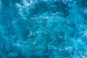 Top view of blue frothy sea surface. Shot in the open sea from above.