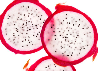 Slices of dragon fruit on white background. Close up. Top view. High resolution product