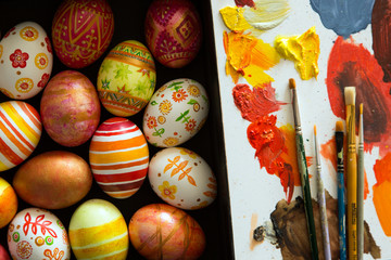 Easter eggs, brushes and paints