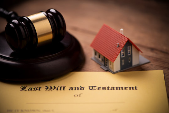 Last will and testament form with gavel. Decision, financial