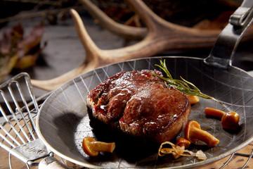 Thick juicy grilled wild venison steak