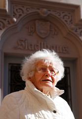 Lisel Heise, a 100-year-old former teacher, poses for a photograph in front of the townhall in Kirchheimbolanden