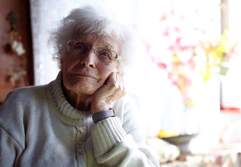 Lisel Heise, a 100-year old former teacher, listens to reporter's questions  inside the living room of her house Kirchheimbolanden