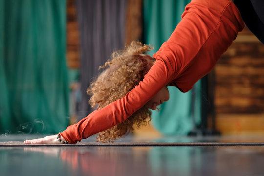 woman practicing yoga Downward facing dog exercise, adho mukha svanasana pose