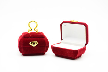 Red velvet box for the ring, fancy ring box, isolated over the white background. Mini red purse ring box..