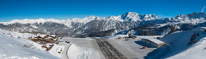 Wall Mural - Altiport airport in a snow covered alpine mountain range