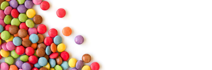 Colorful sugar coated round candies isolated on panoramic white background
