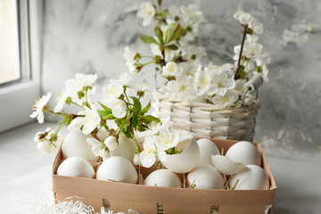 Easter still life. Gentle bright photo of egg and cherry blossoms.