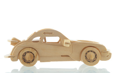 Wooden car with a shadow on a white background side view