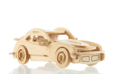 Wooden car with a shadow on a white background front view