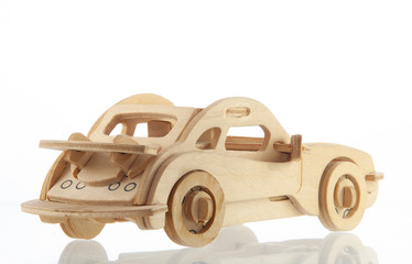 Wooden car with a shadow on a white background back view