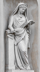Ancient statue of sensual Italian Renaissance Era woman reading a book, Potsdam, Germany, details, closeup