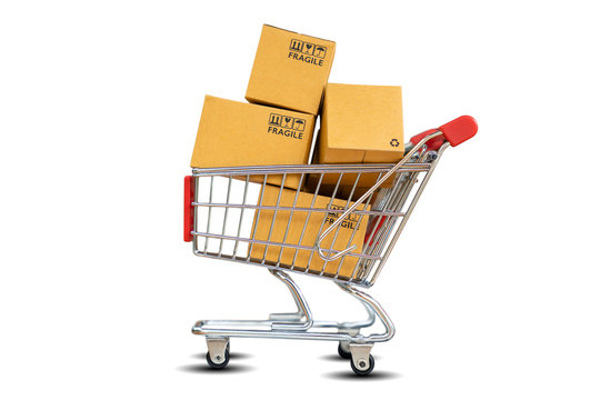 Online Shopping and delivering concept - Shopping cart with product package boxes isolated on white background