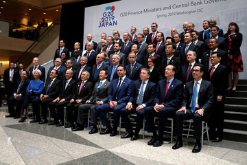 Finance ministers and central bank governors pose for a group photo during the IMF and World Bank's 2019 Annual Spring Meetings, in Washington