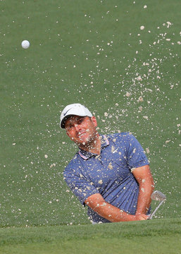 Francesco Molinari of Italy hits to the 2nd green during second round play of the 2019 Masters golf tournament at Augusta National Golf Club in Augusta, Georgia, U.S.