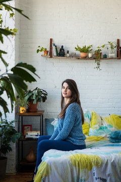 Portrait of a young transgender woman in her bedroom