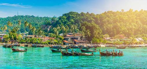 Wall Mural - Tonsai Beach bay with traditional longtail boats parking in Phi Phi island, Krabi Province, Andaman Sea,  Thailand