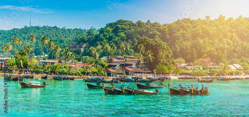 Wall mural Tonsai Beach bay with traditional longtail boats parking in Phi Phi island, Krabi Province, Andaman Sea,  Thailand