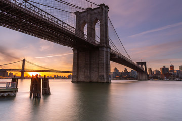 Brooklyn Bridge at sunrise from East River with long exposure photo