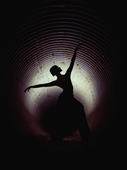 Anonymous ballerina dancing in pipe