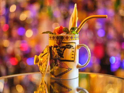 Mug with tropical cocktail