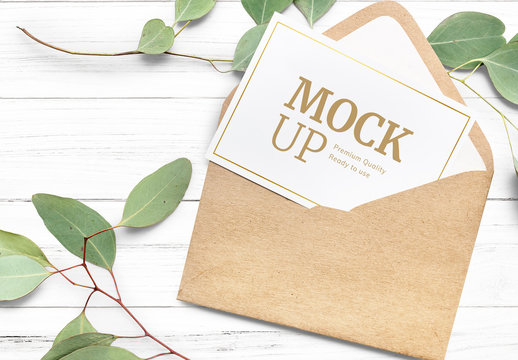 Greeting Card in Envelope on White Table Mockup