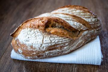 Homemade healthy freshly baked organic whole grain unleavened bread on wooden table