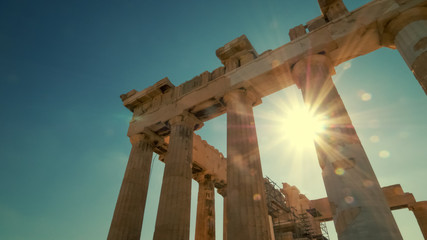 Zelfklevend Fotobehang Athene Sun shines between the columns of the Parthenon at the Acropolis in Athens, Greece
