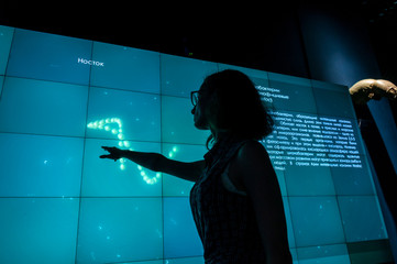 Russia, Vladivostok, July 2018: a girl near an interactive whiteboard in Vladivostok aquarium