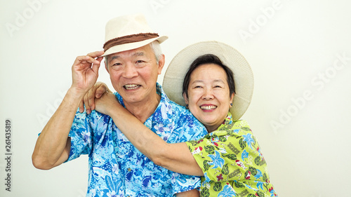 d77b9666a Asian senior couple happy for holiday plan wearing Hawaii shirt and hat