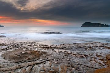 Soft High Cloud Sunrise Seascape from Rock Platform
