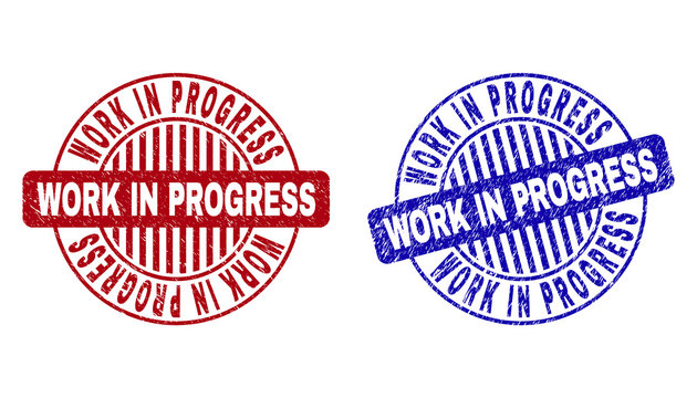 Grunge WORK IN PROGRESS round stamp seals isolated on a white background. Round seals with distress texture in red and blue colors.