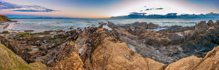 Panorama of dawn at Australia's most Easterly point, Cape Byron, Byron Bay, New South Wales, Australia