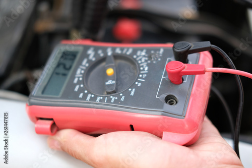 Auto Mechanic Check Car Battery Voltage By Voltmeter Multimeter