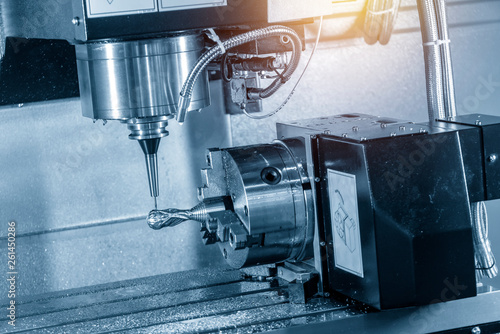 The 5-axis machining center cutting the sample part with