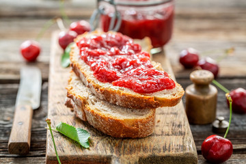 Closeup of fruity sandwich with fresh cherry jam