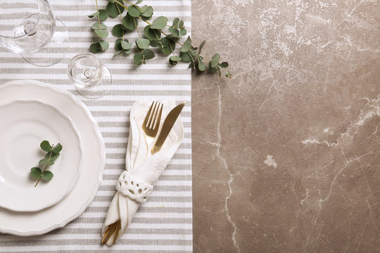 Stylish elegant table setting on marble background, top view. Space for text