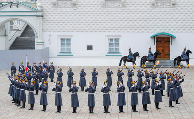 Members of the Presidential Regiment take part in the Changing of the Guard ceremony in the Kremlin