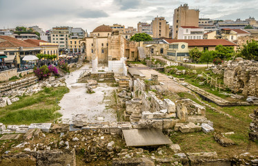 Fototapete - Library of Hadrian in Athens, Greece. It is one of the top landmarks of Athens. Panorama of Ancient Greek ruins in the Athens city center. Cityscape of old Athens in summer evening.
