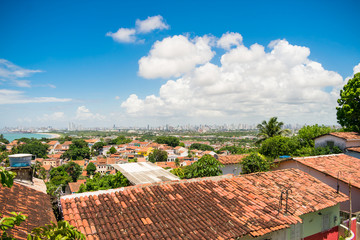 Olinda, Brazil - Circa April 2019: A view of Olinda's historic center from the top of Alto da Se hill, Recife in the background