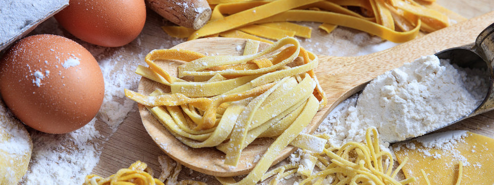 Fresh pasta homemade preparation, closeup view, banner