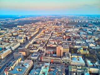 Foto op Canvas WARSAW, POLAND - APRIL 07, 2019: Beautiful panoramic aerial drone view to the center of Warsaw City in the sunset time in spring