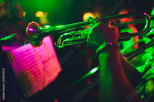 close up of saxophone Player hands playing alto sax musical