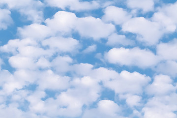 Beautiful blue sky with white fluffy clouds. Natural sky background.