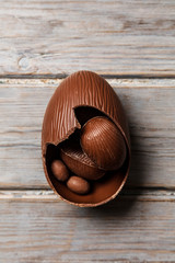 Chocolate easter eggs on a rustic wooden background